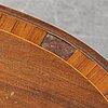 A walnut veneered side table, circa 1900.