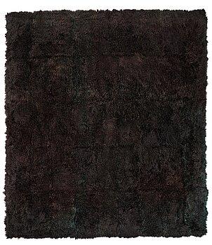 14. A carpet, sheepskins, black dark brown green melange, ca 547 x 492-498 cm.
