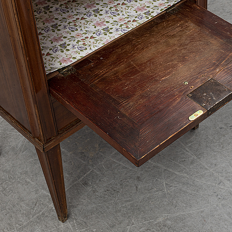 A swedish late gustavian mahogany with marble top bedside table, ca 1800.