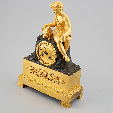 An empire mantel clock, first half of the 19th century.