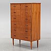 A 1960s teak veneered chest of drawers.