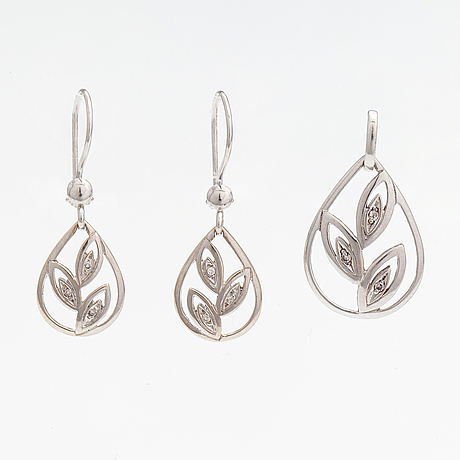 A set of 14k white gold earrings and pendant with diamonds ca. 0.02 ct in total.