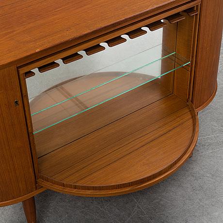 A 1950's teak bar cabinet.