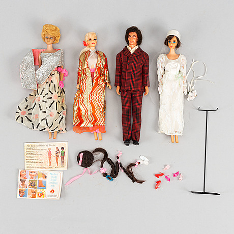 A collection of four mattel 1960's /70's barbiedolls with accessories.