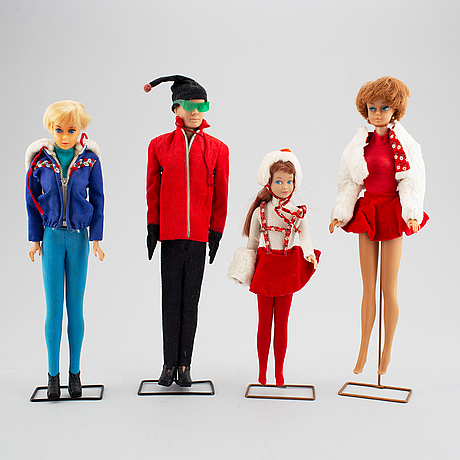 A collection of four mattel 1960's barbiedolls with accessories.