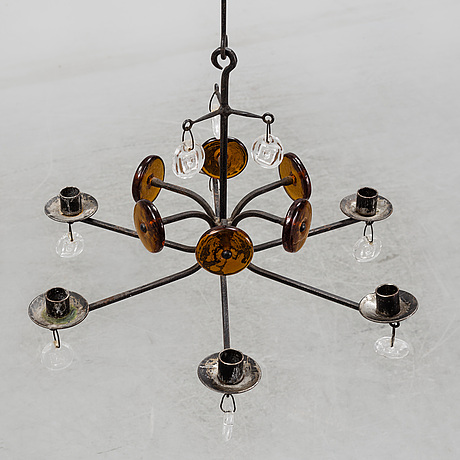 Erik hÖglund, an iron and glass chandelier.
