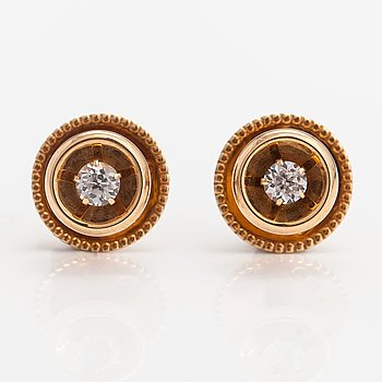 Elis Kauppi,  A pair of 14K gold buttons with rock crystals to a white tie shirt. Kupittaan kulta, Turku.