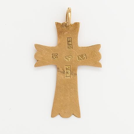 An 18k gold cross. sweden 1876.