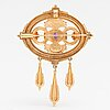 """Otto roland mellin, a 14k gold brooch/pendant """"memory"""" with cultured pearls and an amethyst. kalevala koru, helsinki 1997."""