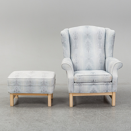 A wing chair and ottoman, late 290th century.