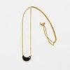 18kts yellow gold onyx and diamond moon necklace.