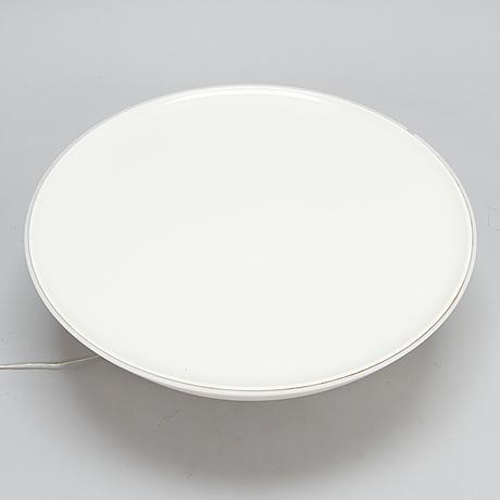 Jean-marie massaud, a floor light coffee table for foscarini, italy.