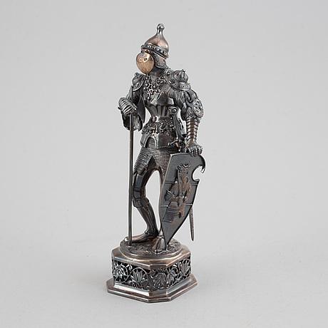 A silver knight figurine in case, pseudo marks.