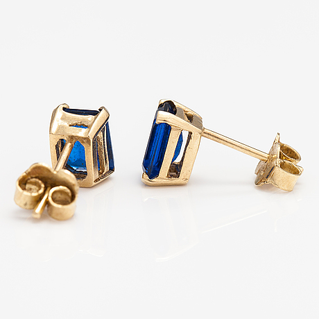 A pair of 14k gold earrings with synthetic spinelles.