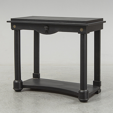 A painted empire style table, circa 1900.