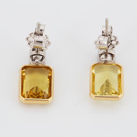 18k gold and platinum yellow beryll (heliodor) and diamond earrings.