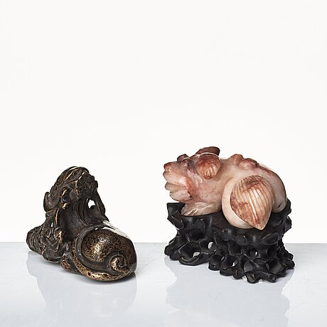 Two sculptures of reclining dogs, qing dynasty.