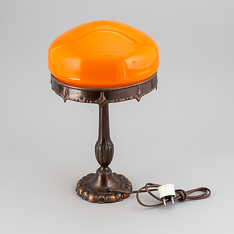 A metal table lamp, first half of the 20th century.