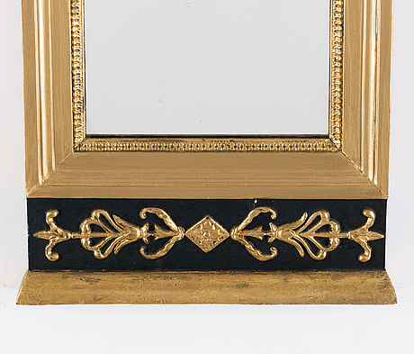 An empire mirror, early 19th century.