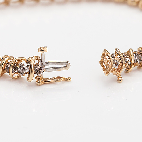 A 14k gold bracelet with light brown diamonds ca. 2.38 ct in total.