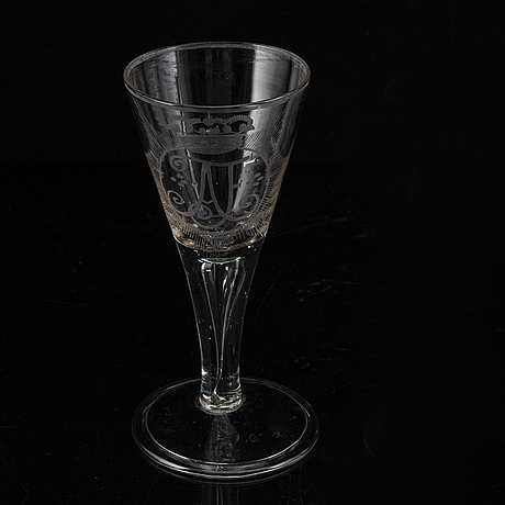 A wine glass with the monogram of the swedish king adolf frederick, 18th century.
