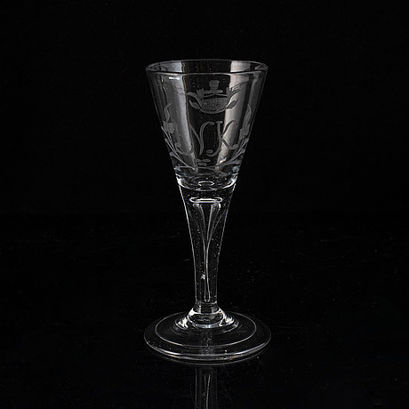 A wine glass, 18th century, with the monogram nk beneath a noble coronet.