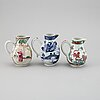 A group of three famille rose and blue and white jugs, qing dynasty, qianlong (1736-95).