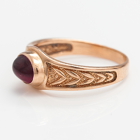 A 14k gold ring and a pair of earrings with synthetic rubies.