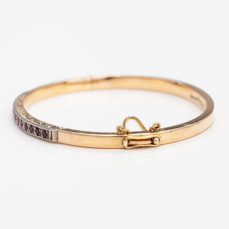 A 14k gold bracelet with synthetic rubies. tarkkanen oy, helsinki 1959.