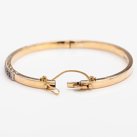 Armband, 14k guld, syntetiska rubiner. tarkkanen oy, helsingfors 1959.