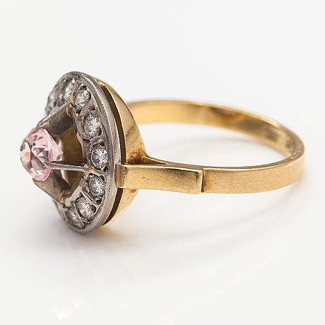 An 18k gold ring with diamonds ca. 0.36 ct in total and a yag garnet. soviet union.