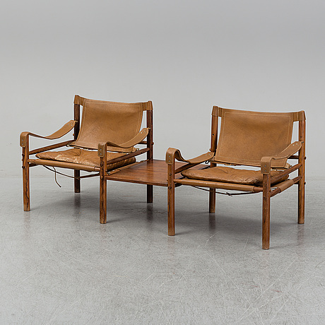 Arne norell, a pair of 'sirocco' rosewood easy chairs with a table, scanform ltd, 1960's/70's.