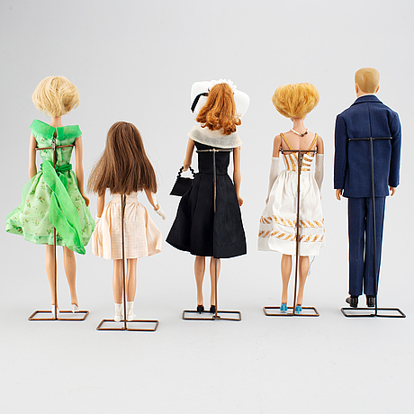 A collection of five mattel 1960's barbiedolls with accessories.