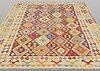 A carpet, kilim, ca 289 x 250 cm.