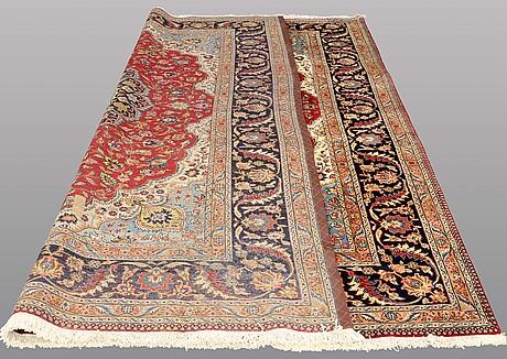 A carpet, tabriz, ca 374 x 295 cm.