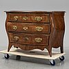 A mid 1700's rococo chest of drawers.