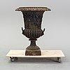 A late 20th century cast iron garden urn.