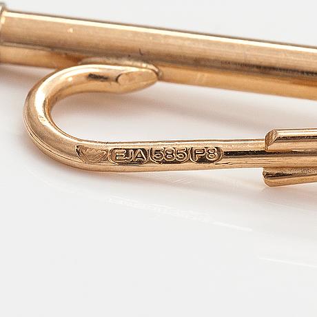 A 14k gold tiepin with a ca. 0.02 ct diamond. einari ailio, jyväskylä 1982.