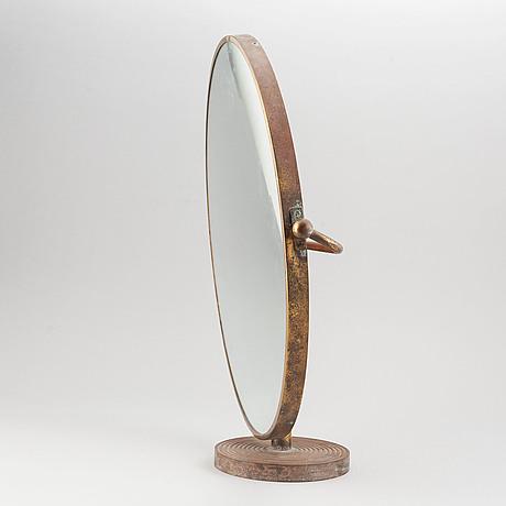 A model 2214 brass table mirror by josef frank for firma svenskt tenn.