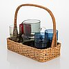 Saara hopea, a glass pitcher and eight glasses in rattan basket, for nuutajärvi. designed year 1952.