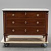 A mahogany veneered chest of drawers, first half of the 19th century.