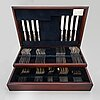 An 84-piece grecian pattern sterling silver cutlery set, carrs, sheffield 1995. in original fitted box.