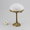A bronze jugend table lamp, early 20th century.
