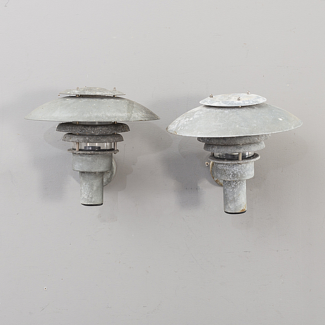 A pair of late 20th century outdoor lights.