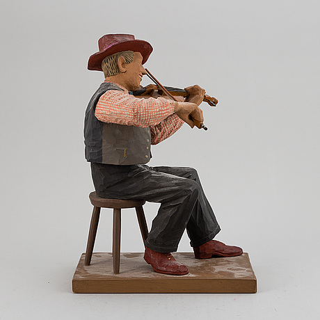 Herman rosell, a painted wooden sculpture.
