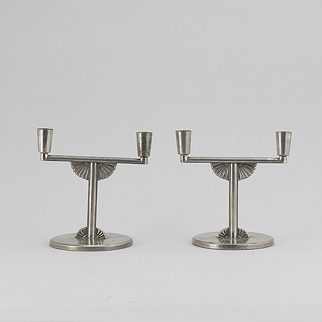 A pair of 1935 pewter candelabras by k e & co.