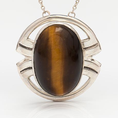 A silver ring and necklace with tiger's eye. kultasepät salovaara, turku 1961.