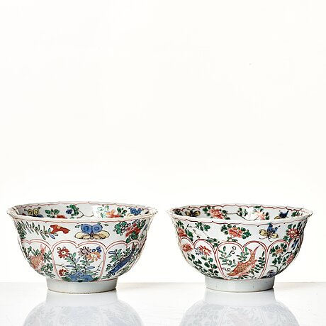 A pair of large famille verte cups with saucers, qing dynasty, kangxi (1662-1722).
