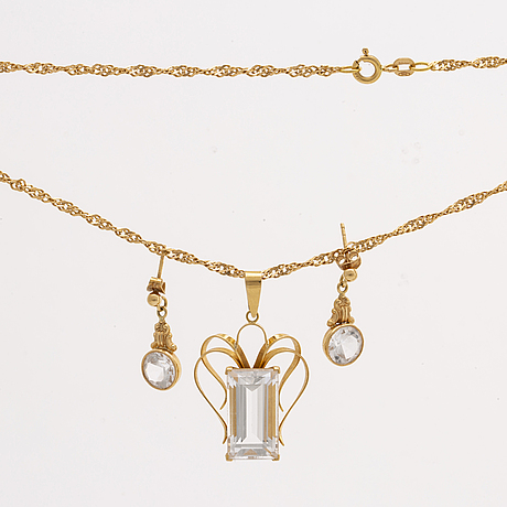 Pendant on chain and earrings, 18k gold and rock crysta (pendant) and spinel (earrings), 1956.