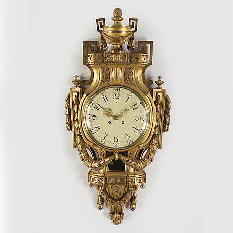 A gilt wooden clock, late gustavian style, mid 20th century.